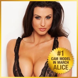 alice goodwin standing in a black lingerie top big busty brunette profile pic