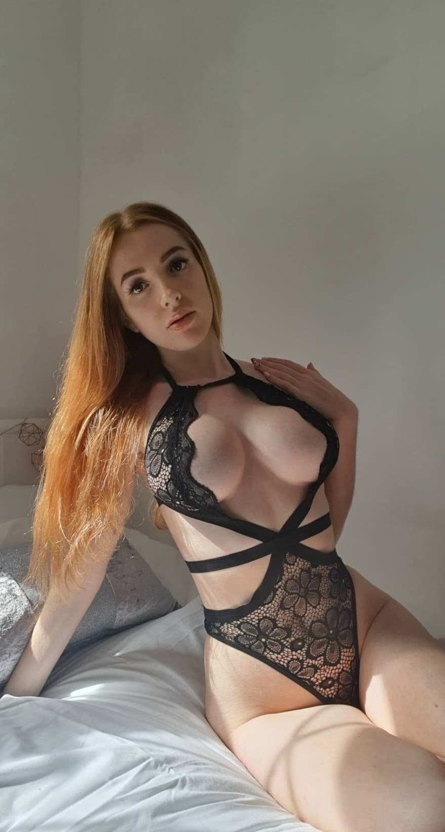 Scarlett Jones in a black lacy body red hair pale skin showing off her big tits slim looking very innocent