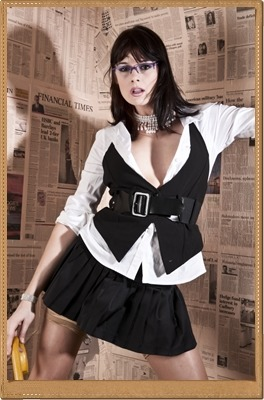 karina currie curvy brunette babe in a white shirt black leather waist coat and leather skirt looking dominant