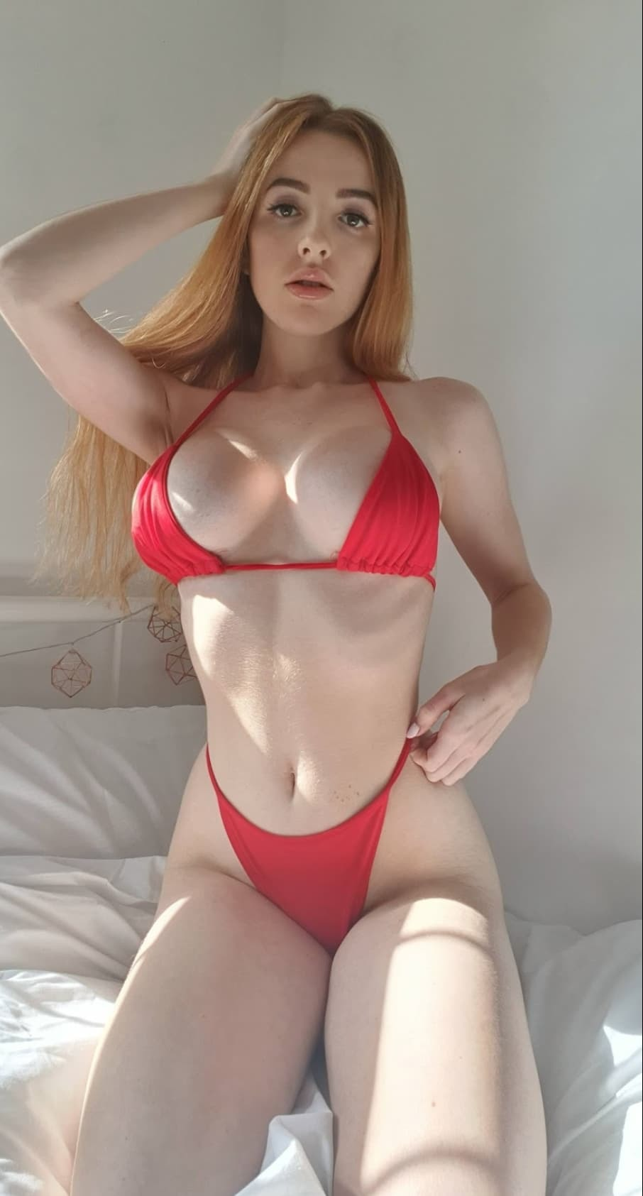 Scarlet Jones in red lingerie standing tall full body facing the camera curvy big boobs