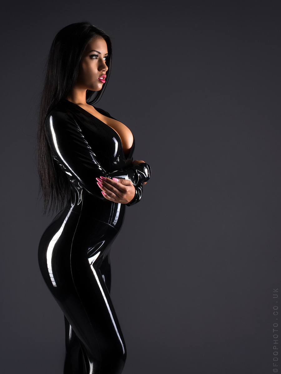 nicole snow tanned curvy Asian full body pose in black latex two piece folded arms showing curves