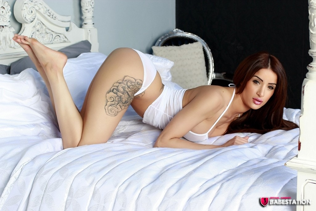 Preeti on all fours bent over on the bed side on showing her curvy figure wearing white lingerie and bare feet